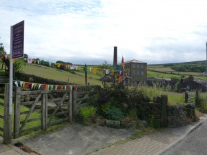 Pecket Well Mill with bicycle and bunting